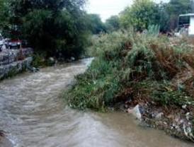 Decenas de infraviviendas embarradas en la zona baja del Guadarrama