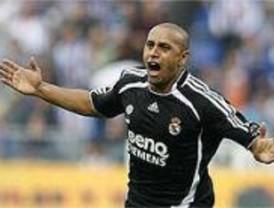 El Madrid se mantiene líder con un gol in extremis de Roberto Carlos