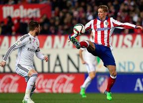 Ramos y Torres en un partido del Atlético de Madrid contra el Real Madrid
