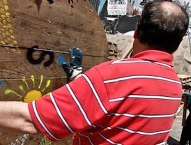 Los indignados desmontan el campamento de Sol bajo el lema 'No nos vamos, nos expandimos'