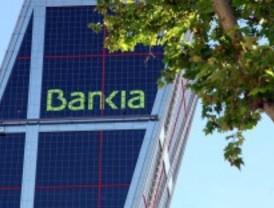 Fitch rebaja el rating de 18 bancos españoles