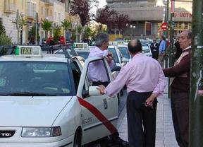 Taxistas en la parada