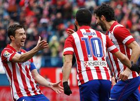 Gabi, Arda y Raúl García celebran un gol.