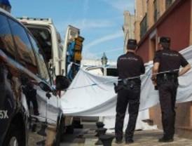 Muere una mujer en un tiroteo entre la policía y unos atracadores en Sevilla