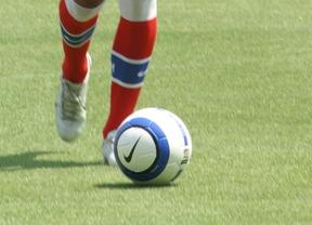 Balón y bota de fútbol