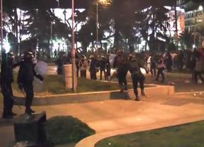 Dos antidisturbios niegan haber agredido a una fotógrafa en las protestas del 22M