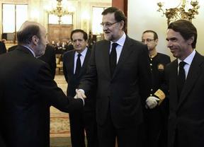 Mariano Rajoy, Alfredo Rubalcaba y José María Aznar en la capilla ardiente de Suárez