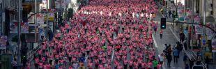 Una marea rosa de 33.000 corredoras tiñe el centro