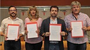 Firma del acuerdo por las políticas de izquierdas.
