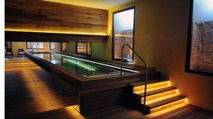 Hotel Urso 5 estrellas boutique, sala del spa con bañeras jacuzzi, sauna y gimnasio