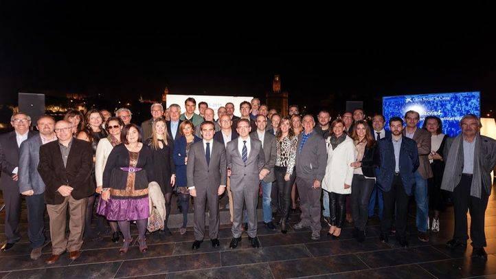 El director general de la Fundación Bancaria la Caixa, Jaume Giró, con representantes de las asociaciones de Voluntarios de la Caixa de toda España