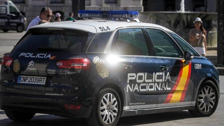 Coche de la Policía Nacional en el centro de Madrid