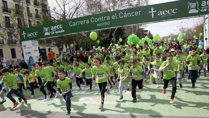 Madrid se tiñe de verde contra el cáncer