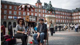 Fotógrafos minuteros: ¿en peligro uno de los oficios más antiguos de Madrid?