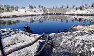 Concentración en la 'laguna del aceite' de Arganda por el parón de su limpieza