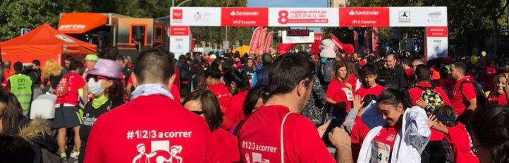 Miles de madrileños corren por los niños y la investigación