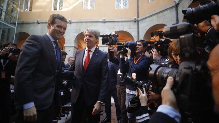 El secretario general del PP, Pablo Casado, junto al presidente regional, Ángel Garrido.