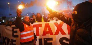 Protestas de los taxistas a las puertas de Ifema horas antes de que comience Fitur.
