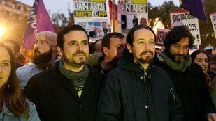 Pablo Iglesias y Alberto Garzón, en una manifestación.