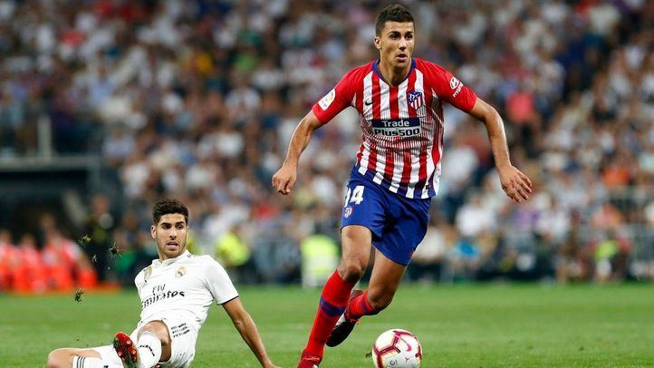 Marco Asensio y Rodrigo Hernández, ambos convocados para el derbi de esta tarde en el Wanda.