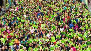 Madrid se tiñe de verde en la carrera contra el cáncer