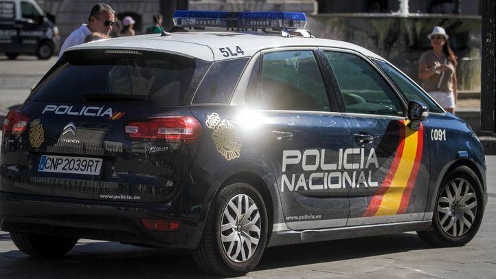 Coche patrulla de la Policía Nacional en las calles de Madrid.