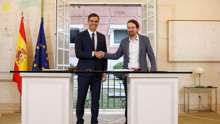 Pedro Sánchez y Pablo Iglesias durante la presentación del acuerdo de Presupuestos entre PSOE y Podemos