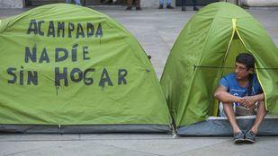 Los sin techo acampados en el Paseo del Prado protestaron frente al Ayuntamiento de Madrid el pasado 31 de julio.