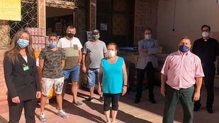 Foto de la donación a Cáritas La Fortuna (Leganés)