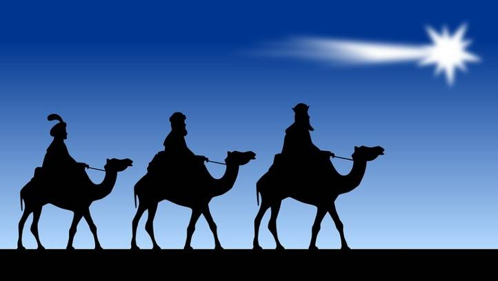 Los Reyes Magos de Oriente siguiendo la estrella hacia el belén